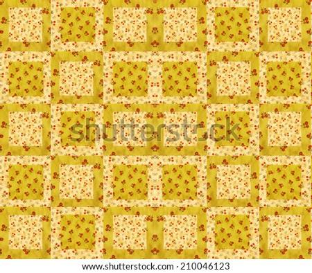 arrangement of quilt squares on batting- cherry design