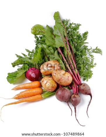 Arrangement of Raw Organic Farmer's Potato, Carrot, Red Onion and Beet isolated on white background