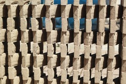 Arrangement of red bricks that are in the process of drying using the heat of the sun.