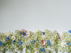 Arrangement with spring flowers for weddings or greeting cards bottom. Backdrop with copy space