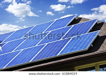 Array of alternative energy photovoltaic solar panels on roof