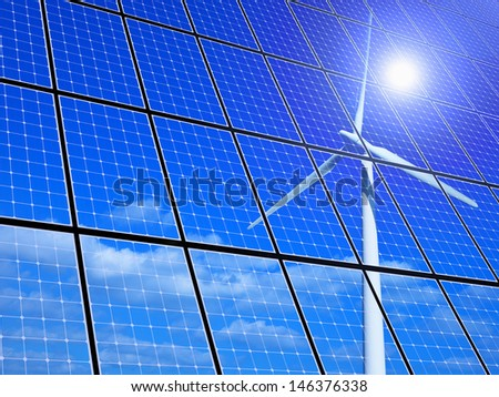 Array of solar panels with wind turbine reflection