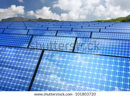arrayed solar panels with mountain background