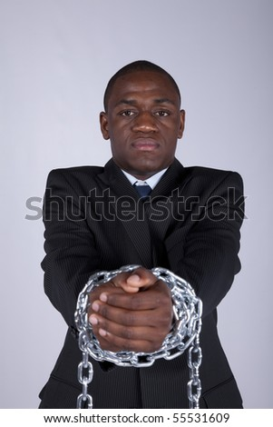 Arrested african businessman with a steel chain in his hands