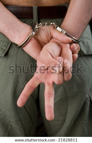 Arrested man showing peace sign