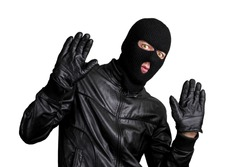 Arrested masked thief with raised arms isolated on white background