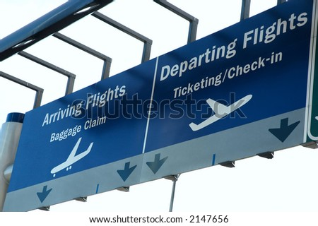 Arrival and departure sign outside an airport