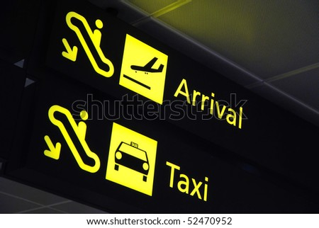 Arrival and taxi signages at the airport for concepts related to travel and transportation, aviation and airport, and vacation.