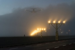Arrival of a plane at Schiphol airport in the Netherlands on a foggy morning