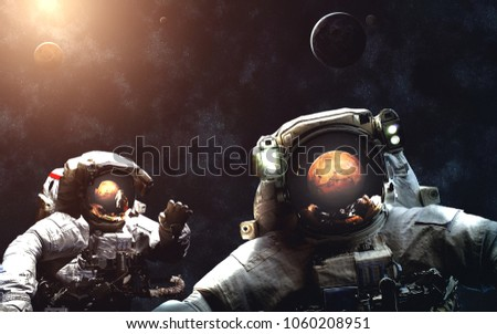Arrival to Mars. Astronauts. Solar System. Image in 5K resolution for desktop wallpaper. Elements of the image are furnished by NASA