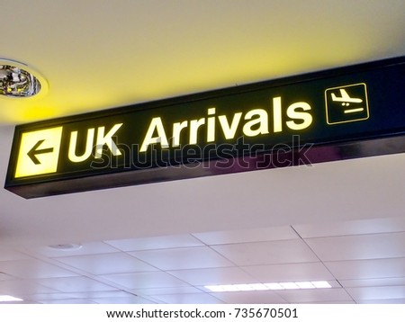 Arrivals Sign at an airport in the UK, indicating where passengers must go to pass though immigration and Border Force Agency checks. #735670501