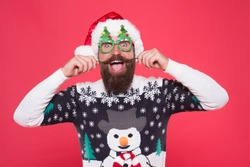 Arrive in style to Chritmas events. Bearded man in santa claus style. Happy hipster twirl mustache. Festive holiday style. Christmas and new year celebration. Fashion for winter. Celebrate in style.