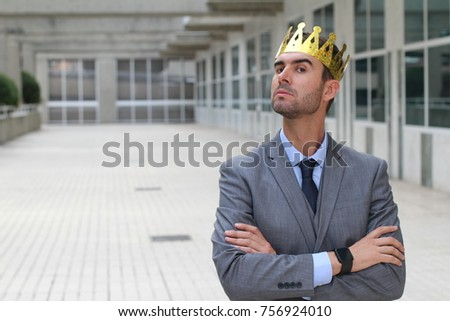 Arrogant businessman with a crown in office space Stock fotó ©