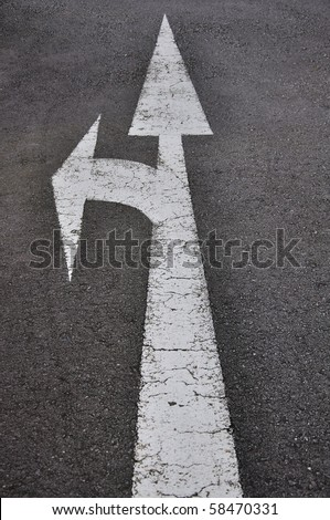 Arrow ahead or turn left on street - stock photo
