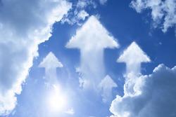 Arrow cloud shape on blue sky metaphor as keep on moving forward