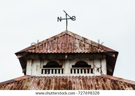 Stock Photo arrow compass on a vintage  pavilion