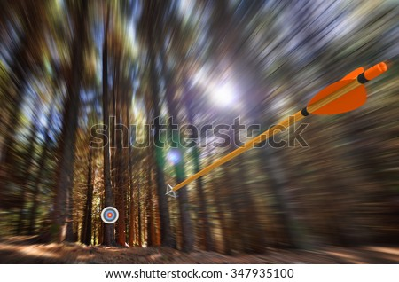 Arrow flying to target with radial motion blur