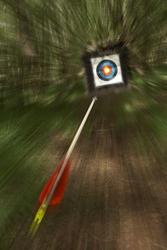 arrow flying towards archery target shoot