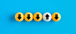 Arrow icons on table tennis balls in a row with one uploading while others are downloading. Network transfer, upload and download traffic concept.