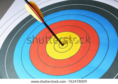Arrow in the center of target for archery, closeup