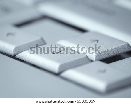 arrow keys on the computer keyboard,selective focus and blue toned, for navigation or computer themes