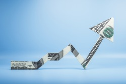 Arrow made of dollars on blue background. Finance and trade concept. 3D Rendering