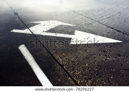 Arrow of traffic on the pavement under water