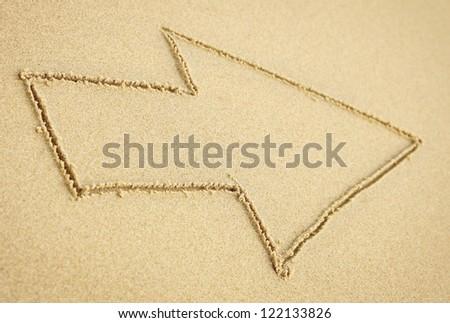 Arrow on beach sand
