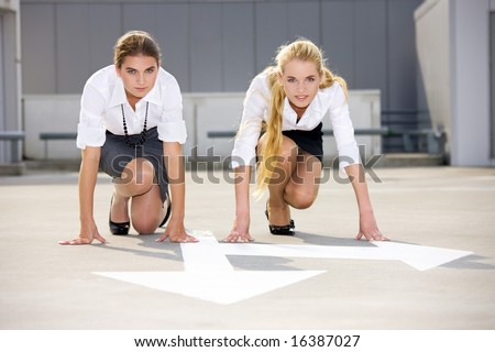 arrow pointer and two confident businesswomen ready for race
