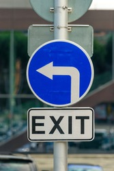 Arrow road sign left with EXIT