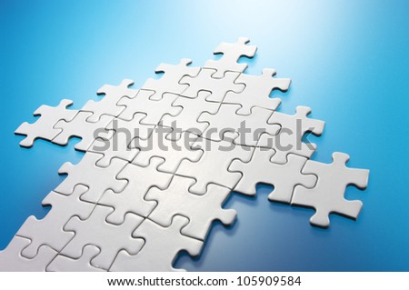 Arrow shaped jigsaw puzzle. Concept image of growth,success and building a business.