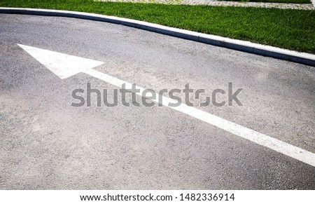 Arrow sign marked on the road