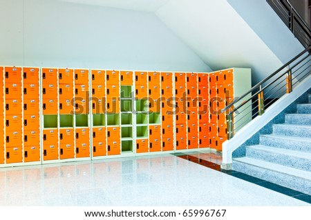 arrow sign on orange lockers