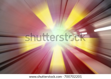 Arrow sign zooming through a colorful tunnel.  #700702201