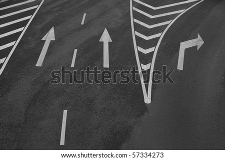 Arrow signs and other markings on asphalt