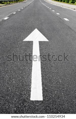Arrow signs as road markings on a street
