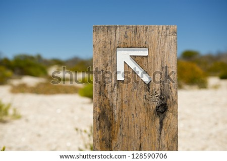 Arrow signs outside pointing the way on a walking trail