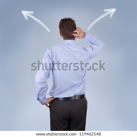 Arrow signs showing two different directions with a businessman scratching his head concept for confusion, choice and decisions