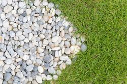 Arrow stone and green grass
