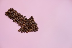arrow with coffee on a pink background