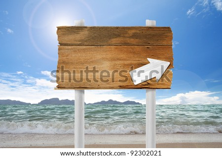 arrow wooden  sign on beach