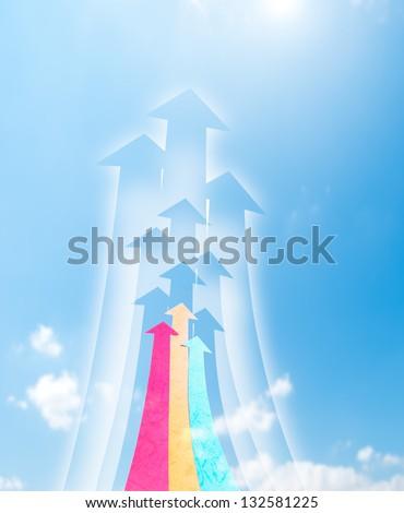 Arrowheads fly upward to sky. Arrowheads shape made by paper.