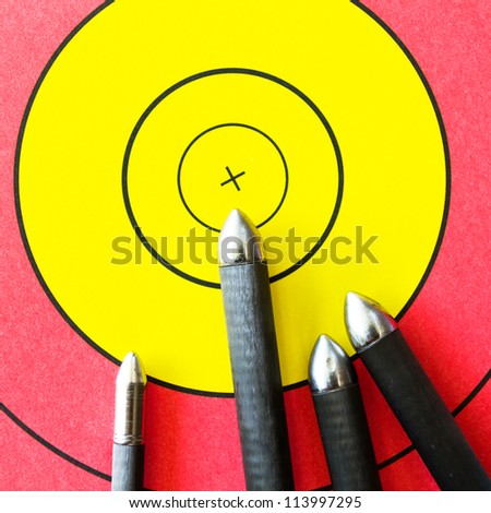 Arrows and archery target