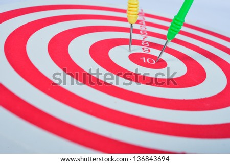 Arrows dart hitting the center of a target, success business concept
