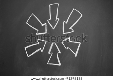 arrows drawn with chalk on blackboard