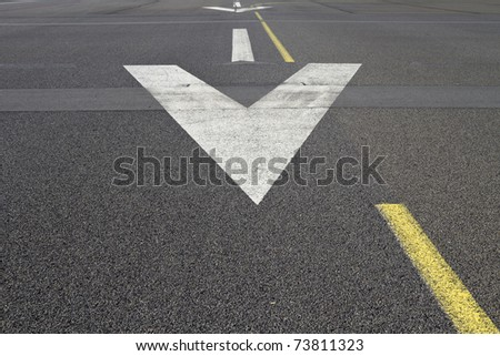 Arrows on the surface of a runway