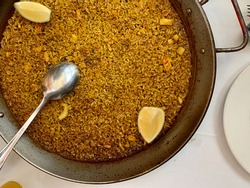 Arroz a banda, a delicious traditional meal from Valencia and Alicante (Spain), made with rice, fish and seafood similar to paella