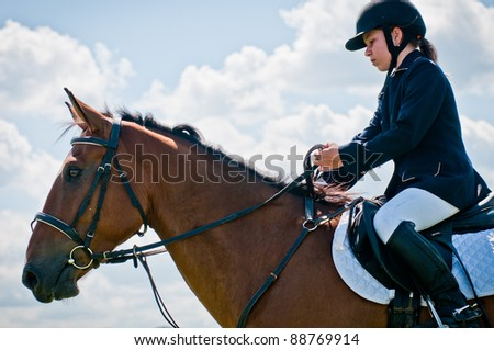 """ARSENEV, RUSSIA - SEPTEMBER 03:  Unidentified rider in action rides horse and jumps at the Riding show """"The Cup of the Governor of the Primorsky Territory, 2011"""" on Sept 03, 2011 in Arsenev, Russia"""