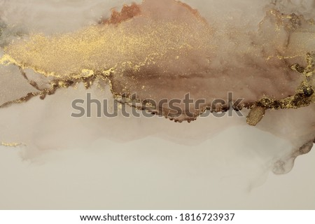 Art Abstract  watercolor flow blot painting. Color brown and gold marble texture background. Alcohol ink.