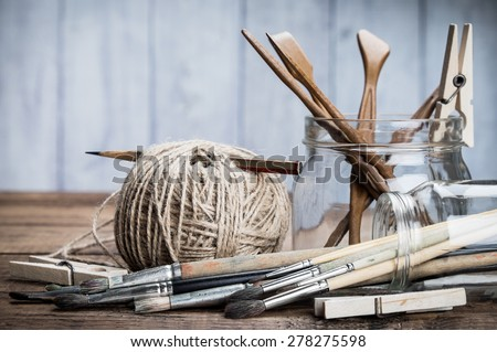 Art and craft tools set. Grunge wooden background.